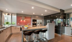 Diamond Creek area, integrated pantry and fridge feature panelling in High Gloss lamiwood.