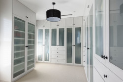 Concept Cabinets created this luxurious walk in robe with opaque glass doors
