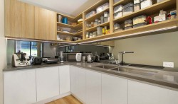 Personalised butler's pantry keeps the work space out of sight.