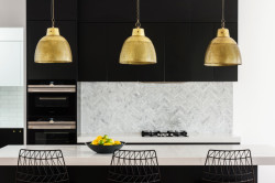 This Northcote kitchen is the ultimate in color contrast, with its Classic White and Black matt vinyl doors and stone tops