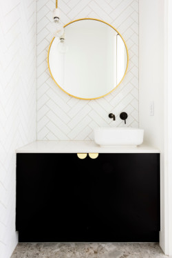 This small space vanity in Northcote looks classic and classy with matt vinyl doors, stone top and gold handles
