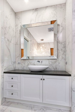 Doreen - Concept Cabinets designed this painted vanity to fit this angled wall to use all the space to the max