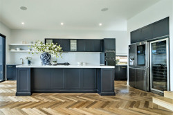 Stylish Hamptons in Dromana. Kitchen with Shaker style doors in a rich Oxford blue, 60mm stone tops, then elegant gold handles to complete the look.