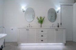 Park Orchards: Bathroom Vanity with  2 Pac Painted Shaker Style Doors. LED in kicker as highlighted feature. Stone top.