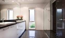 High Gloss vinyl kitchen with 40mm Caesarstone tops in contrast Black.