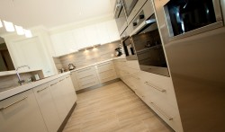 Croydon area, 2 pack painted gloss kitchen with stainless steel look kickers and 40mm Caesarstone tops.