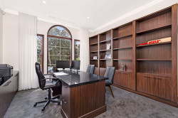 Doreen - Office space with wall to wall  wood grain finish cupboards